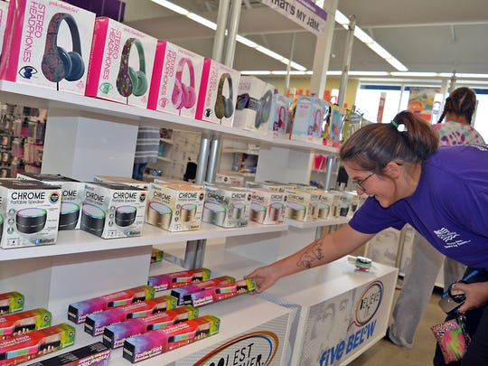 Kala Jones, of Pearl, enjoys her shopping experience at the newly opened Five Below store.