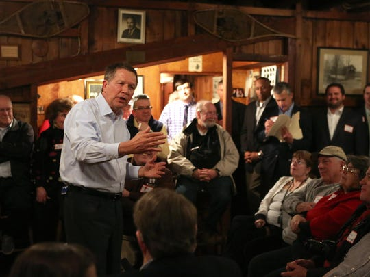 Ohio Gov. John Kasich will fly to New Hampshire Tuesday for two and a half days of campaigning. Here, Kasich takes a few questions from voters after a speech in March, on his first visit to New Hampshire.