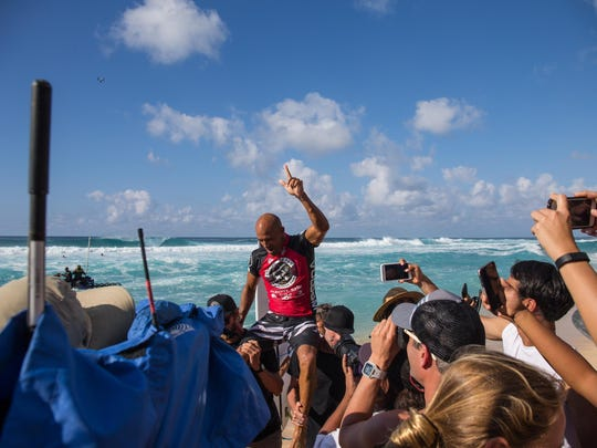 Kelly Slater uis carried off the beach after winning the Volcom Pipe Pro.