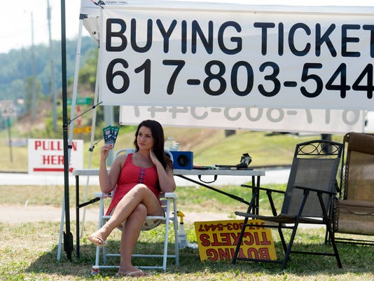 Scarlett Hodge offers tickets for for sale along Highway 394 Wednesday, Sept. 7, 2016, in Blountville, Tenn, for the Pilot Flying J Battle at Bristol at Bristol Motor Speedway on Saturday when Tennessee and Virginia Tech will play in an NCAA college football game. An anticipated crowd in excess of 150,000 is expeted (Saul Young/Knoxville News Sentinel via AP)