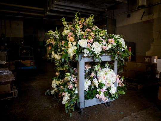 A cart full of flowers wait by the loading dock of the Cincinnati Art Museum Saturday, September 24, 2016. The flowers were used at a wedding the previous evening and will be repurposed as part of ReBloom, a volunteer organization in partnership with Robin Wood Flowers that repurposes donated flowers after weddings and delivers them to hospital patients and other nonprofit organizations in Greater Cincinnati.