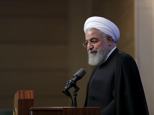 In this photo released by the official website of the office of the Iranian Presidency, President Hassan Rouhani speaks in a meeting with a group of university teachers, in Tehran, Iran, Monday, May 21, 2018. In response to Secretary of State Mike Pompeo's speech on Iran, President Hassan Rouhani described the speech as unacceptable and took issue with the fact that the secretary of state previously led the CIA, long demonized in Iran for its role in a 1953 coup. Pompeo in his speech on Monday demanded wholesale changes in Iran policies post-nuke deal. (Iranian Presidency Office via AP)