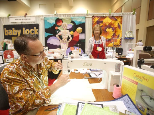 """Palm Springs resident and quilter Jerry Grenata uses a modern sewing machine to create a design during the first """"QuiltFest Oasis Palm Springs"""" at the Palm Springs Convention Center."""