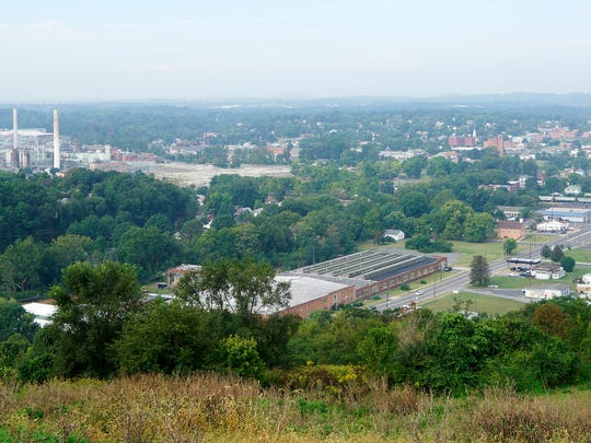 A view of downtown Waynesboro as seen from the top of the future Sunset Park, being developed on the site of the city's old municipal landfill which closed in 2005. Photo was taken on Wednesday, Sept. 21, 2016.