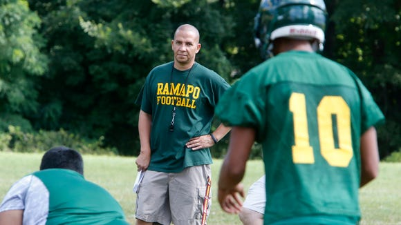 Coach Kevin Bullock during the first day of football practice at Ramapo High School on Aug. 18, 2014.