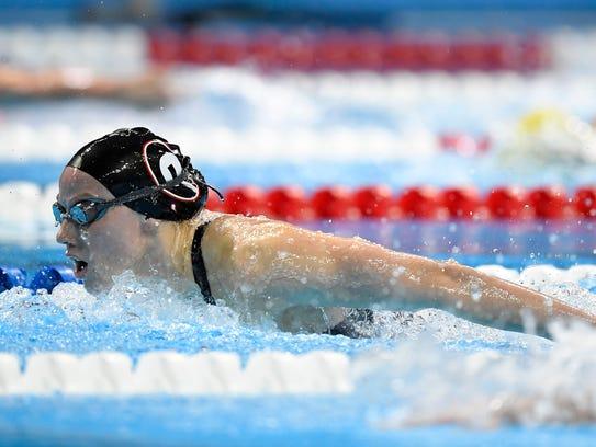 Hali Flickinger swims in the women's 200-meter butterfly