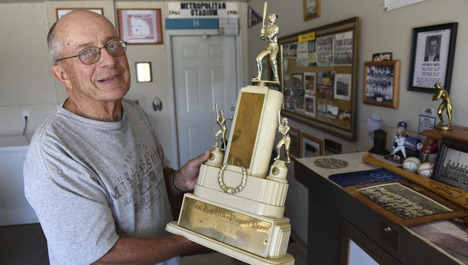 Dave Bell holds the trophy for the 1955 Cold Spring Springers championship at his home in St. Cloud.