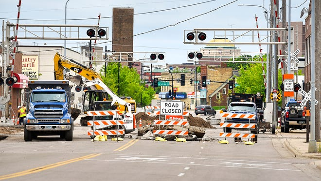 East St. Germain Street is closed and work is underway to widen the road and install a raised median at the rail crossing Tuesday, May 30, between Lincoln Avenue and Wilson Avenue.