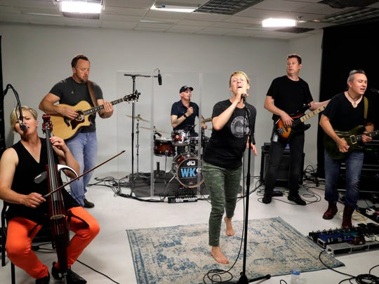 Betsy Ade & The Well-Known Strangers will be at Kadish Park on Aug. 6. Band members shown in the Journal Sentinel studio include Betsy Ade, lead vocalist; Sacia Jerome, cellist; Roger Gower, drums; Theodore Koth, lead guitar; John Kulas, bassist; Joe Adamek, rhythm guitar.
