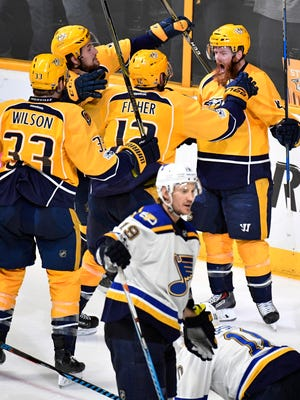 The Predators celebrate with defenseman Ryan Ellis (4) after his goal during the third period in game 4 of the second round NHL Stanley Cup Playoffs at the Bridgestone Arena Tuesday, May 2, 2017, in Nashville, Tenn.