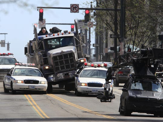 Filmmakers shoot a police chase scene on East Main Street in downtown Rochester in May 2013 for The Amazing Spider-Man 2, the largest movie production in the state's history.