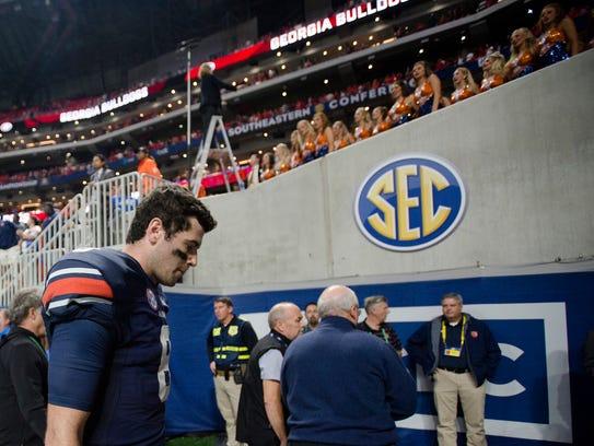 Auburn quarterback Jarrett Stidham (8) walks off the