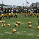 The Green Bay Packers take the field for their first minicamp practice on Tuesday.