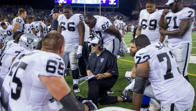 Raiders assistant head coach/offensive line Tony Sparano talks to his team on Aug. 8.