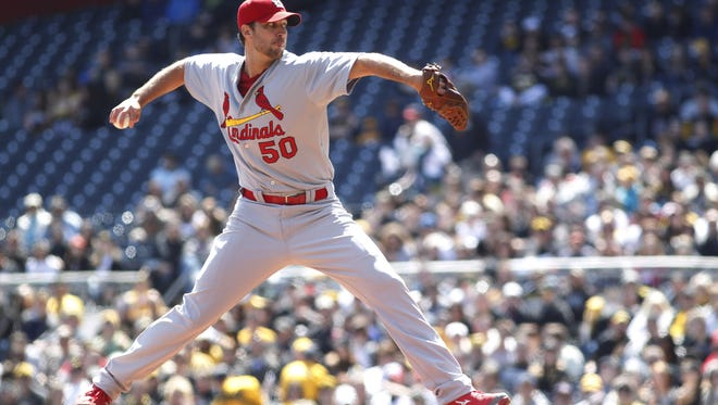 Cardinals starting pitcher Adam Wainwright delivers a pitch against the Pittsburgh Pirates on April 6.