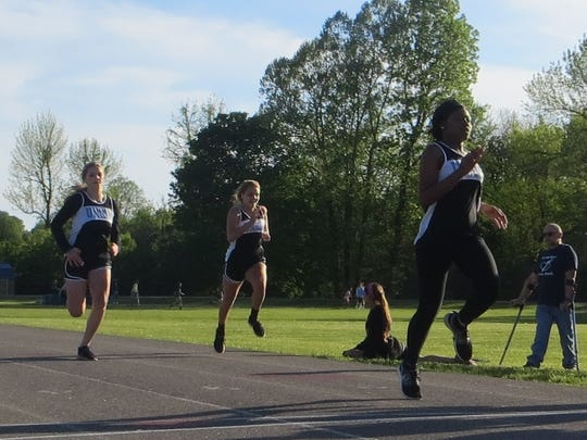 Beyonca Allen, Olivia Wheatley, and Anna Wheatley in the 200 meter run. The girls saw a 1,2,3 finish.