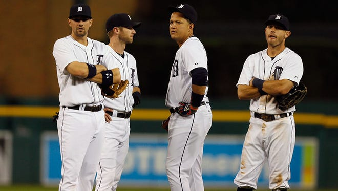 (From left) Tigers infielders Nick Castellanos, Andrew Romine, Miguel Cabrera and Ian Kinsler wait for a pitching change tonight at Comerica Park.