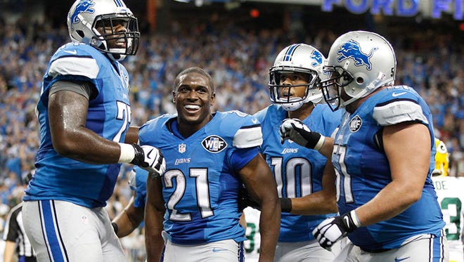 The Lions celebrate Reggie Bush's touchdown run in last week's win over the Packers at Ford Field.