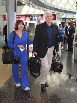 Indiana Gov. Mike Pence and his wife, Karen, are shown preparing to board the plane for the governor's first trade mission to Japan in September 2013.
