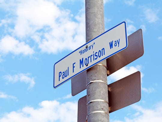 "The street sign along Forest Avenue pays tribute to Paul Morrison as Bulldog fans come together and celebrate a living legend during the 100th Birthday Party for ""Mr. Drake"" Paul Morrison in the Courtside Club of the Knapp Center, 2601 Forest Ave, in Des Moines."