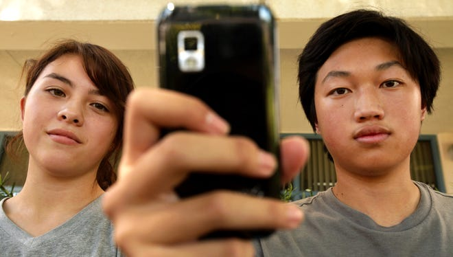 This portrait of Young Cho,  left, 16, and Christopher  Chung, right, 16, taken Thursday in front of their school Herbert Hoover High School in Glendale, Calif.
