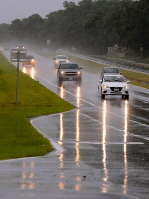 Traffic makes its way along Hwy. 98 Sunday afternoon. With portions of Hwy 98 flooding during the storm of 2014, transportation and storm drains are a priority for commissioners.