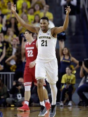 University of Michigan guard Zak Irvin reacts after