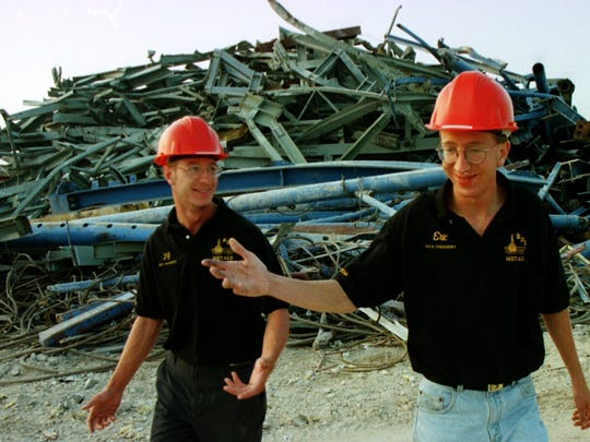 Ted Burrows, left and his brother, Eric Burrows, vice presidents of B&B Metals Processing Co. of Newton, stand by scraps they hauled from the site of a crane collapse at Milwaukee's Miller Park. The crane collapsed exactly 15 years ago Monday.