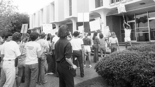 In this 1980 file photo, Alexandria Senior High and Bolton High students are shown picketing in front of the Rapides Parish School Board office to show their displeasure with the delay in the opening of schools because of the community uproar over the federal court order that changed school zones and closed several schools.