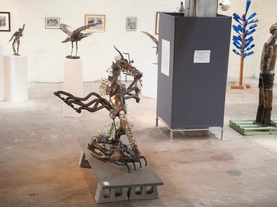 """A sculpture entitled """"Dragon"""" , foreground, made from recycled steel parts by artist Tom Peterson is part of the Found Artist Exhibition at the Perkins Center for the Arts in Collingswood.  08.01.14"""