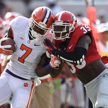 Aug 30, 2014; Athens, GA, USA; Clemson Tigers wide receiver Mike Williams (7) is pushed out of bounds by Georgia Bulldogs safety Corey Moore (39) during the first quarter at Sanford Stadium. Mandatory Credit: Dale Zanine-USA TODAY Sports