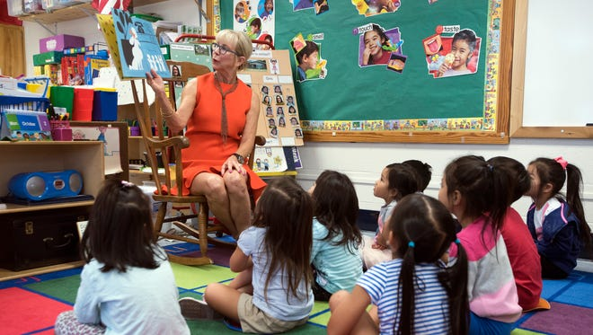 Florida first lady Ann Scott reads to students on Monday, Oct. 2, 2017, at McMillan Preschool in Pensacola.. During her visit, Scott read to children in two different classrooms.