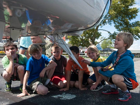 Students from Aerospace4kids, an summer camp focused on flight, flying, airplanes and helicopters, held at the Flying W Airport in Medford, tour the New Jersey State Police helicopter on the last day of camp on Friday, August 15, 2014.