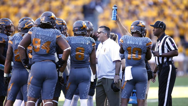 Arizona State head coach Todd Graham talks to his team during the Territorial Cup game Arizona at Sun Devil Stadium in Tempe on November 21, 2015.