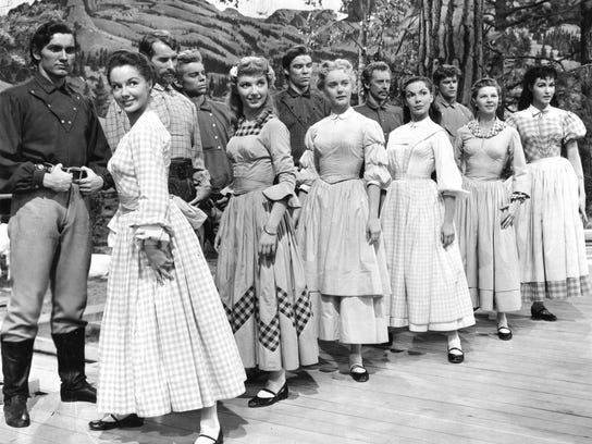 1. Cast of Seven Brides for Seven Brothers. Ruta Lee, second from left oppos
