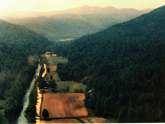 An aerial view, top, shows a slice of historic Jocassee Valley, with the lodge visible at the end of the clearing.