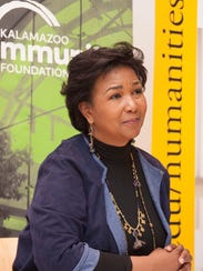 Astronaut Mae Jemison listens as a question is asked