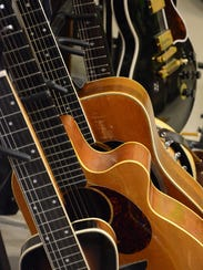 Guitars fill up racks in JRobert's studio.
