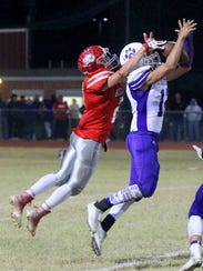Jacksboro's Fernando Piedra nearly intercepts a pass in the Tigers' district title showdown against Holliday in November.