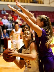 Richard Cleaver / Special for the Times Record News Whitney Taylor didn't see her outside shot fall early but after a scoreless first half she attacked the basket determinedly and scored 14 in the second half Thursday as MSU defeated Tarleton State, 66-56.