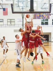 Four Coldwater defenders go up for a rebound Tuesday