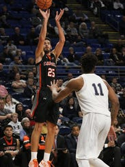 Campbell University's  Andrew Eudy (25) puts up a shot