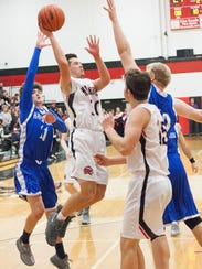 Marshall senior Wyatt Crow goes up for a shot during the Redhawks win over Harper Creek on Friday.