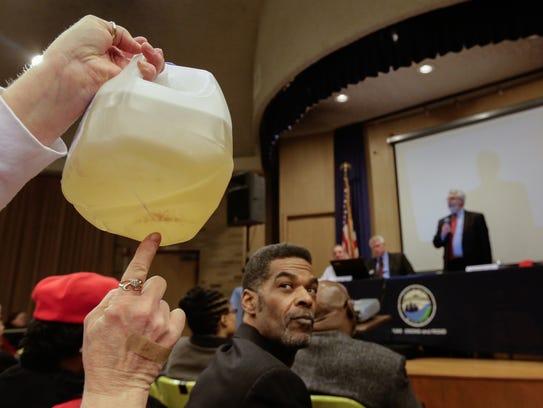 Flint City Councilman Eric Mays looks as Flint resident