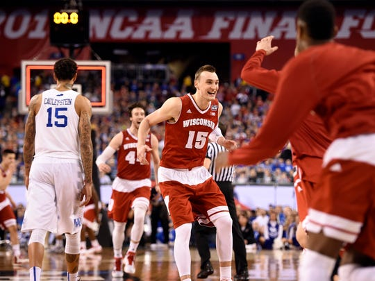 Apr 4, 2015: Wisconsin Badgers forward Sam Dekker (15) celebrates with teammates after defeating the Kentucky Wildcats in the 2015 NCAA Men's Division I Championship semi-final game at Lucas Oil Stadium.