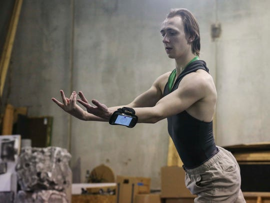 Devin Tokarski, a professional dancer for Ballet Des Moines rehearses for the upcoming production of Snow White on Monday, March 27, 2017, at the Ballet Des Moines studio in West Des Moines. While rehearsing Tokarski wears a cell phone transmitting a Bluetooth signal to a movement controlled robot creating art based on his motion.