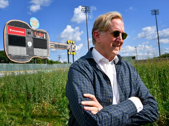 """Music producer T Bone Burnett stands June 13, 2017, in the outfield of the old Sounds stadium, where he has proposed an """"arts and music generator"""" as part of a mixed-use development at the site."""