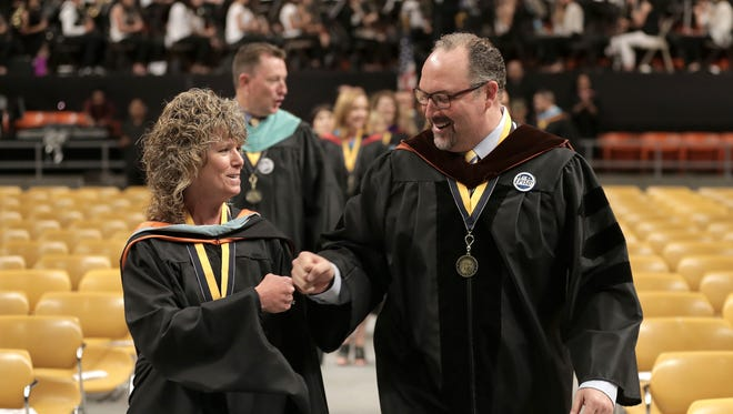 EPISD Superintendent Juan Cabrera bumps fists with Coronado High School Principal Angela Henderson as they enter the Don Haskins Center for the Thunderbirds' graduation ceremony in this undated file photo. Henderson was named assistant superintendent for middle schools on Monday.