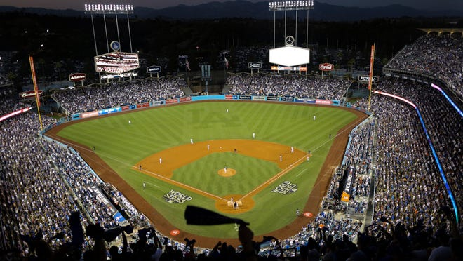 The Houston Astros and the Dodgers play in Game 2 of the World Series at Dodger Stadium on Oct. 25, 2017  in Los Angeles. Dodger Stadium's 40-year wait to host the All-Star Game is going to last even longer. The game scheduled for July 14 was canceled Friday because of the coronavirus pandemic, and Dodger Stadium was awarded the 2022 Midsummer Classic.