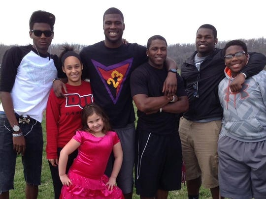 Dorial Green-Beckham (third from left) in the Beckhams' front yard in Springfield, Mo., on Easter 2013. He has his left arm around his cousin, Mikael Falls-Cooper, who will be living with him in Nashville. Green-Beckham's biological brother, Darnell, is at the far left.